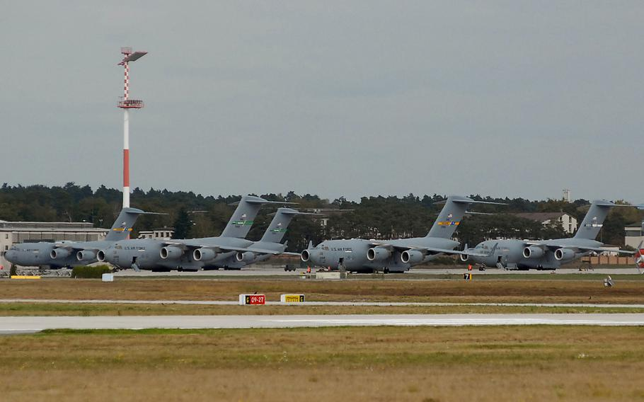 U.S. Air Force C-17 Globemaster IIIs sit on the flight line at Ramstein Air Base, Germany. The German prosecutor?s office in Kaiserslautern says it is looking into a report that the Pentagon used Ramstein Air Base to transport weapons covertly to rebel fighters in Syria, an allegation, that if true, might have broken German law.