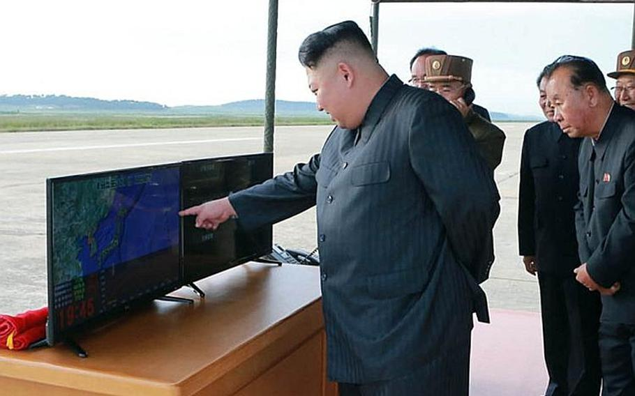 This image of North Korean leader Kim Jong Un and other officials was released by the Korean Central News Agency a day after Pyongyang test-fired a missile over Japan on Friday, Sept. 15, 2017.