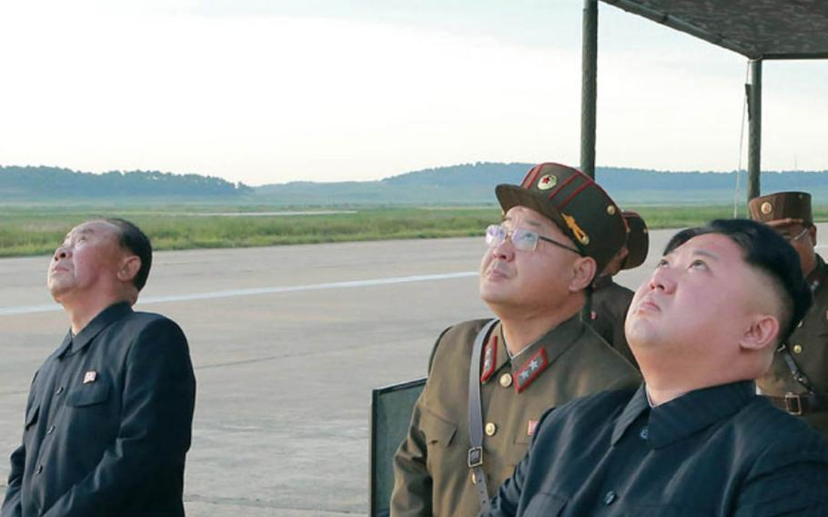 This image of North Korean leader Kim Jong Un and other officials watching a launch was released by the Korean Central News Agency a day after Pyongyang test-fired a missile over Japan on Friday, Sept. 15, 2017.