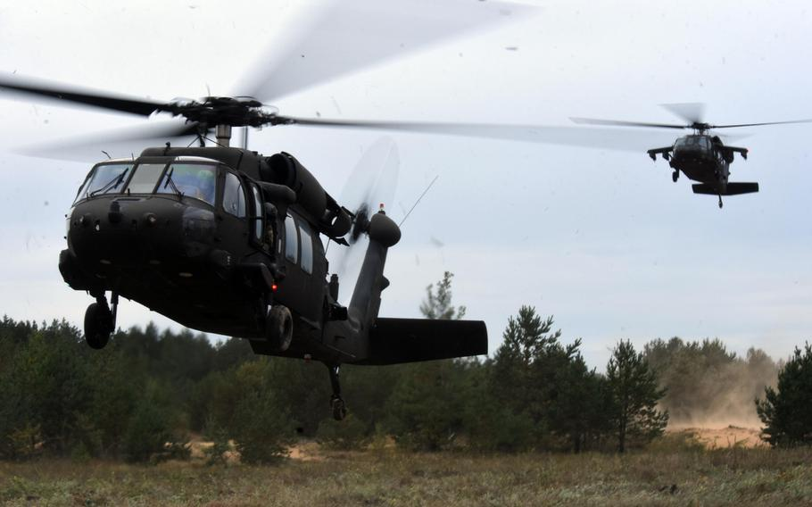 U.S. Army UH-60 helicopters land to transport U.S. and Slovenian soldiers during Exercise Bayonet Shield in Adazi, Latvia, Sept. 19, 2017.