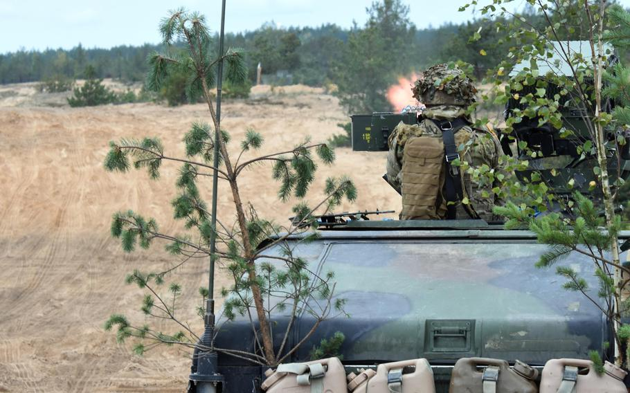 A U.S. soldier with the 173rd Infantry Brigade fires a .50-caliber machine gun from atop a Humvee during live-fire training in Pabrade, Lithuania, Sept. 20, 2017.