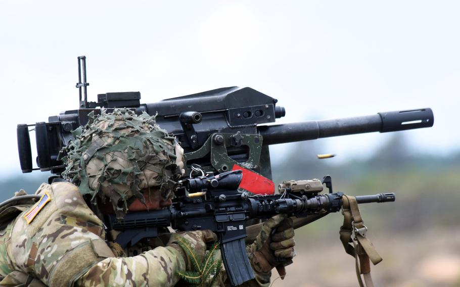 A U.S. soldier with the 173rd Infantry Brigade Combat Team (Airborne) fires an M4 carbine from atop a Humvee during live-fire training in Pabrade, Lithuania, Sept. 20.