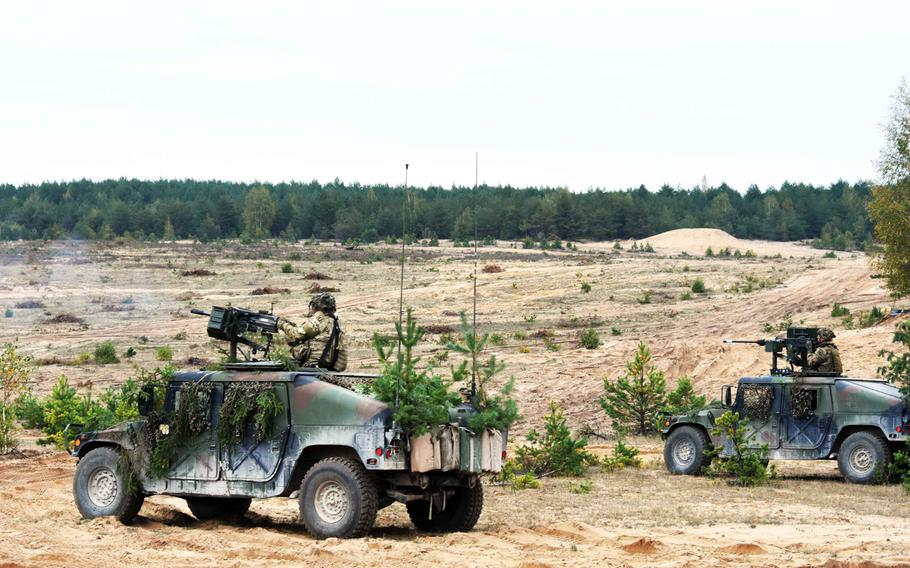 U.S. soldiers with the 173rd Infantry Brigade fire from atop Humvees during live-fire training in Pabrade, Lithuania, Sept. 20, 2017.