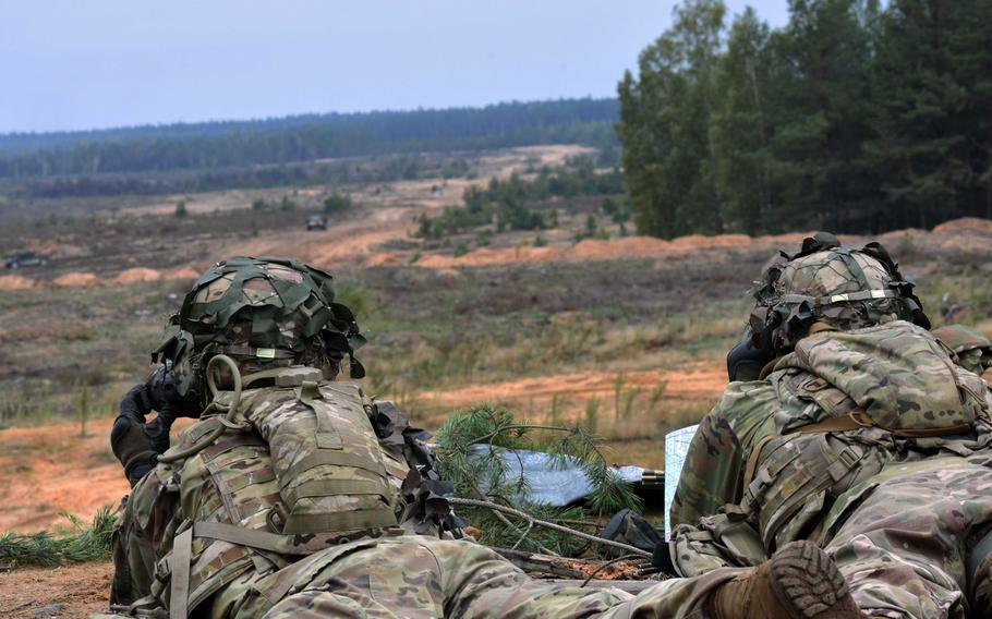 U.S. soldiers with the 173rd Infantry Brigade observe the training area during live-fire training in Pabrade, Lithuania, Sept. 20, 2017.