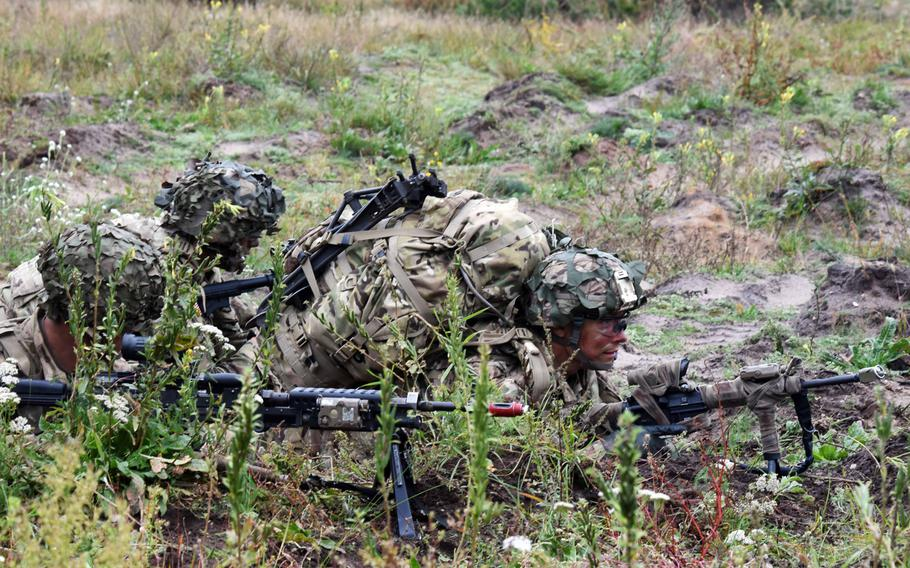 U.S. Army soldiers with the 173rd Infantry Brigade provide cover during Exercise Bayonet Shield in Adazi, Latvia, Sept. 19, 2017.
