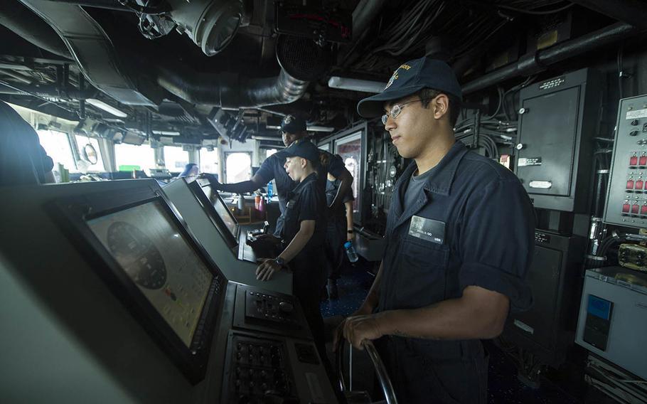 Seaman Daniel Oo stands watch aboard the USS Pearl Harbor on July 30, 2017.