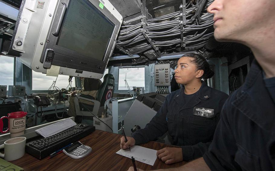Petty Officer 3rd Class Bridgette Olivieri stands watch aboard the USS America on Aug. 3, 2017.