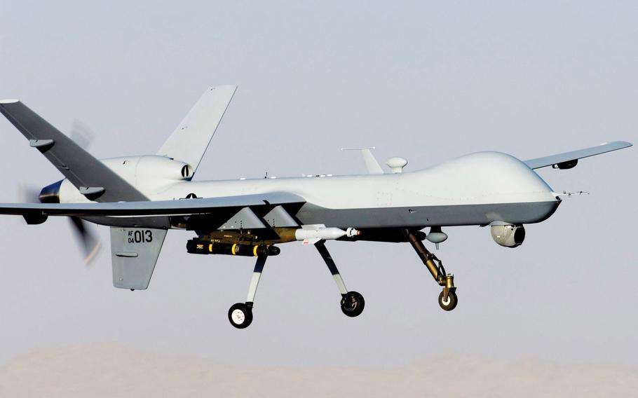 A MQ-9 Reaper lands on an air field in Afghanistan.