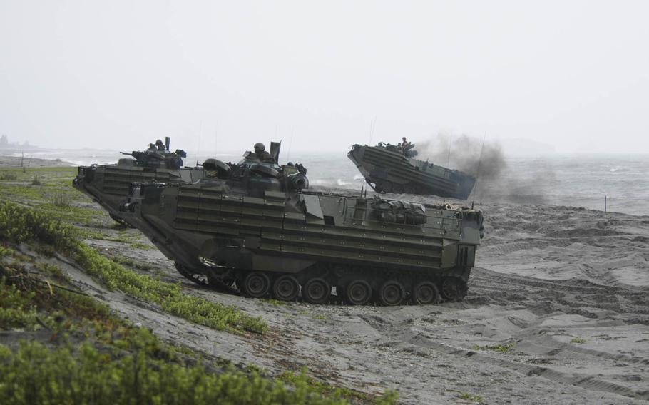U.S. and Philippine Marines participating in last year's PHIBLEX drills land on a beach on the island of Luzon in amphibious-assault vehicles.