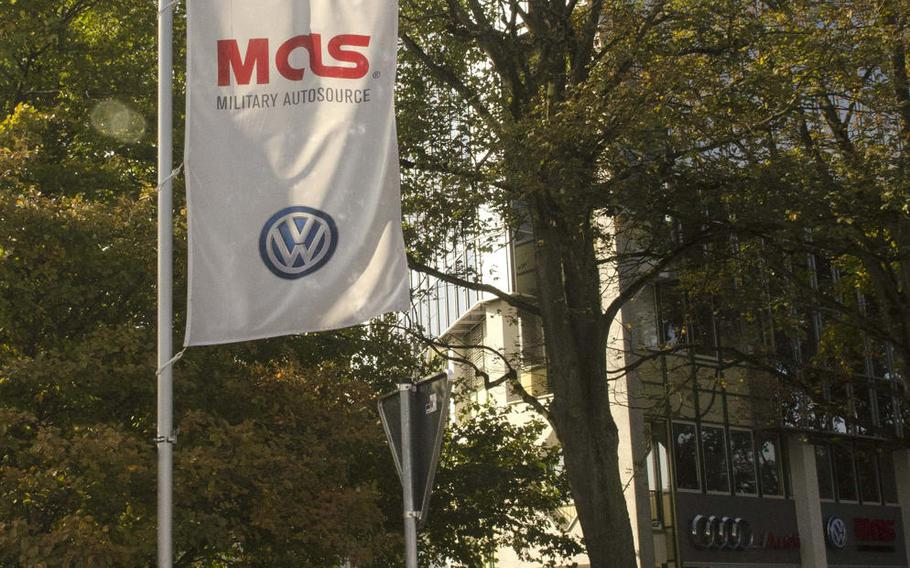 Cars sit outside the Military AutoSource location near Hainerberg housing area in Wiesbaden, Germany, Thursday, Sept. 21, 2017. MAS is acting as a middleman for servicemembers and civilians overseas who have been affected by the Volkswagen emissions fraud settlement.