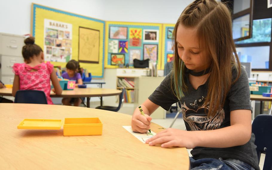 Embree Bench, a second-grader at Ramstein Elementary School in Germany, designs a name tag on the first day of school on Monday, Aug. 28, 2017.Classes for schools in the Kaiserslautern Military Community and Baumholder will start one hour late on Thursdays this month.
