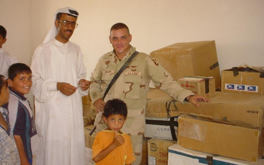 Dr. Mohammed Ismail, left, and then-Maj. Fred Wellman, are pictured here on Sunday, Aug. 10, 2003, in a U.S.-built clinic alongside boxes sent by the American public for ''Operation Fred,'' a campaign to collect school supplies, medicine and other necessary goods after the U.S.-led invasion of Iraq.