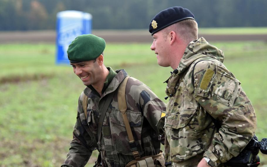 A British paratrooper and French Foreign Legionnaire share a laugh during Exercise Swift Response, at Hohenfels, Germany, Oct. 9, 2017.