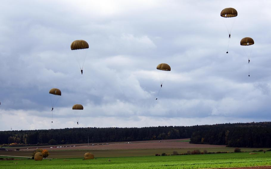 French Foreign Legion and British paratroopers land in a drop zone outside Hohenfels, Germany, during Exercise Swift Response, Oct. 9, 2017.