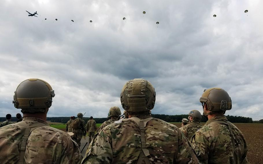 U.S. soldiers observe French Foreign Legion and British paratroopers land in a drop zone outside Hohenfels, Germany, during Exercise Swift Response, Oct. 9, 2017.