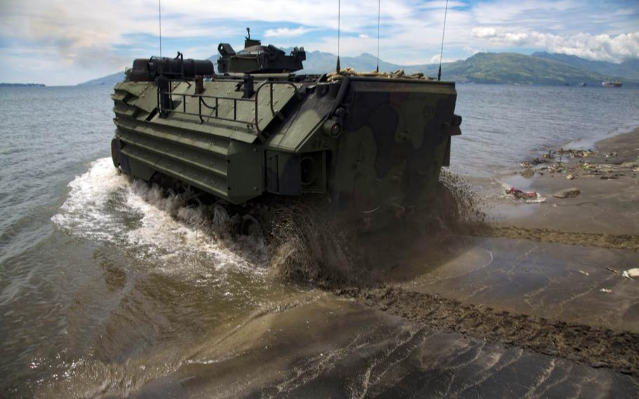 Marines with Amphibious Assault Company, Combat Assault Battalion, 3rd Marine Division, load Assault Amphibious Vehicles onto the Philippine navy's BRP Tarlac during exercise Kamandag in Subic Bay, Philippines, Oct. 2, 2017.