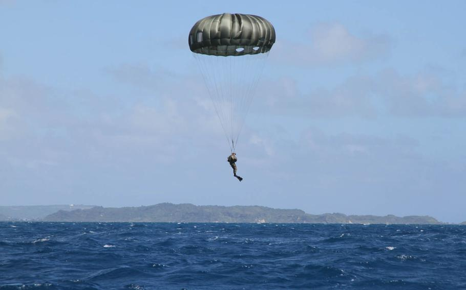 A Marine from 3rd Reconnaissance Battalion, 3rd Marine Division, prepares for splashdown during parachute training off Okinawa's eastern coast, Wednesday, Oct. 11, 2017.