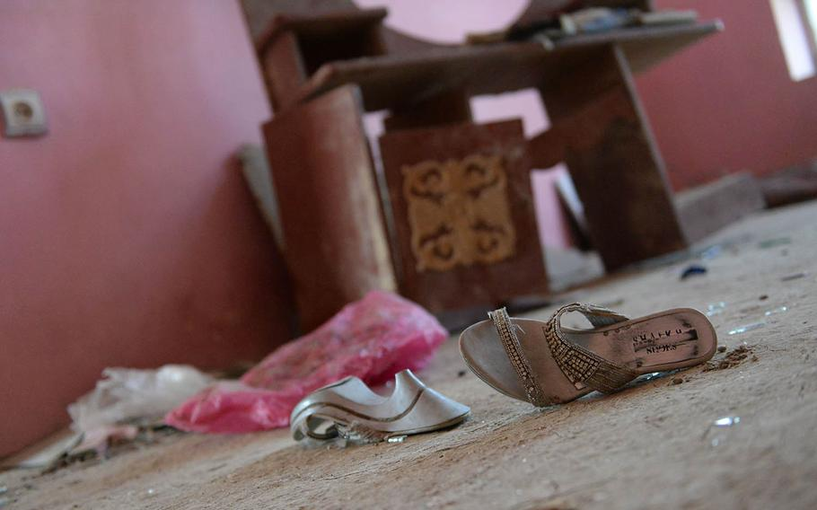 Shoes, broken glass and other debris litter the floor of a Kabul house on Oct. 8, 2017, after a U.S. missile struck it by mistake more than a week before.