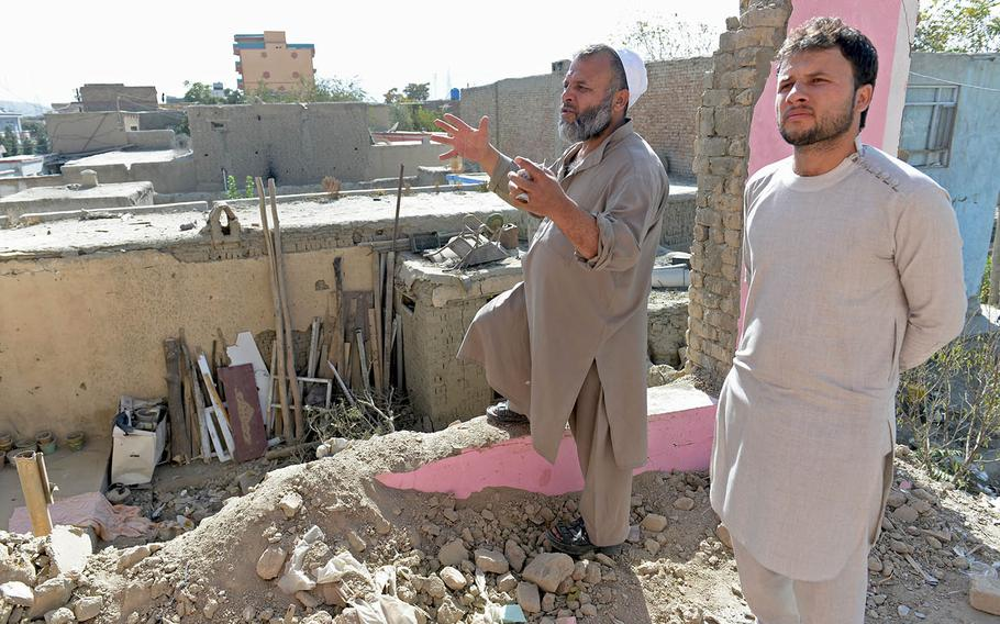 Ghulam Rabani, left, and his nephew Fardin, who like many Afghans uses just one name, stand in a second-story room of their home in Kabul on Oct. 8, 2017. Rabani explains how a U.S. missile destroyed the house more than a week before, injuring several family members.