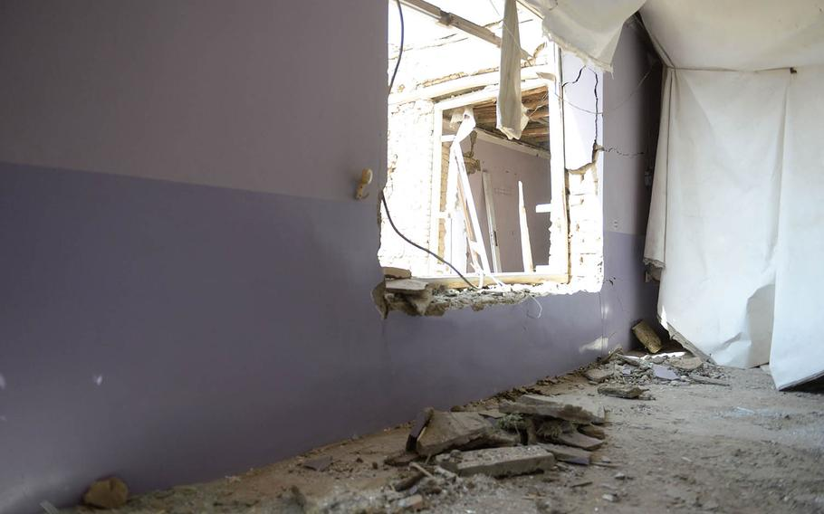 Glass and other debris litter the room of a home in Kabul on Oct. 8, 2017. A U.S. missile mistakenly hit the house more than a week before, destroying it and injuring several people.