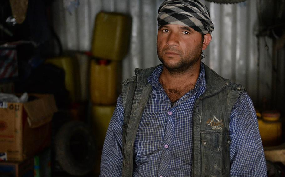 Tamim, who like many Afghans uses just one name, stands in his workshop on Oct. 8, 2017. He was in his workshop more than a week before when he heard a U.S. missile hit his family home a short distance a way, injuring several of his family members.