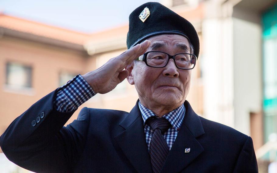 Battle of Chipyong-ni veteran Park Dong-ha salutes during the unveiling of a statue at Camp Red Cloud, South Korea, Monday Oct. 16, 2017.