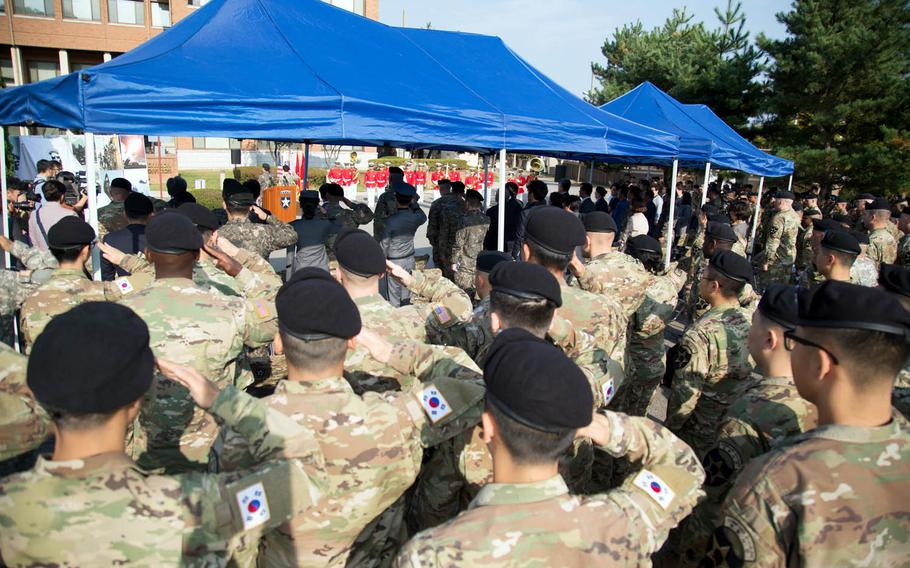 U.S. and South Korean soldiers assigned to the 2nd Infantry Division salute during a ceremony at Camp Red Cloud, South Korea, Monday, Oct. 16, 2017.