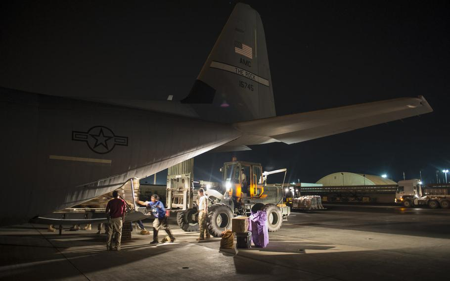 Airmen from the 449th Air Expeditionary Group load cargo onto a C-130 plane for a Combined Joint Task Force-Horn of Africa mission in Somalia, May 26, 2017.