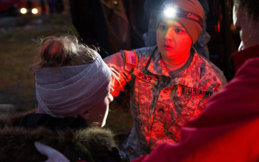 Cpl. Karen Aponte, practical nurse specialist with Medical Support Unit-Europe, 7th Mission Support Command, helps treat a role-playing casualty with assistance from a local paramedic during an exercise in Bosnia and Herzegovina, Sept. 27, 2017. The Army is considering increasing reimbursements for reservists traveling to drills and long-term training.