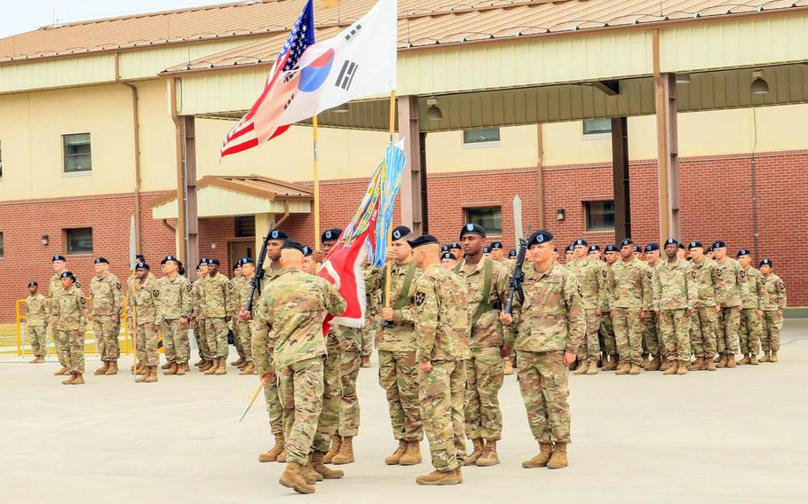 The 11th Engineer Battalion unveils its colors for the first time during an activation ceremony at Camp Humphreys, South Korea, Wednesday, Oct. 18, 2017.