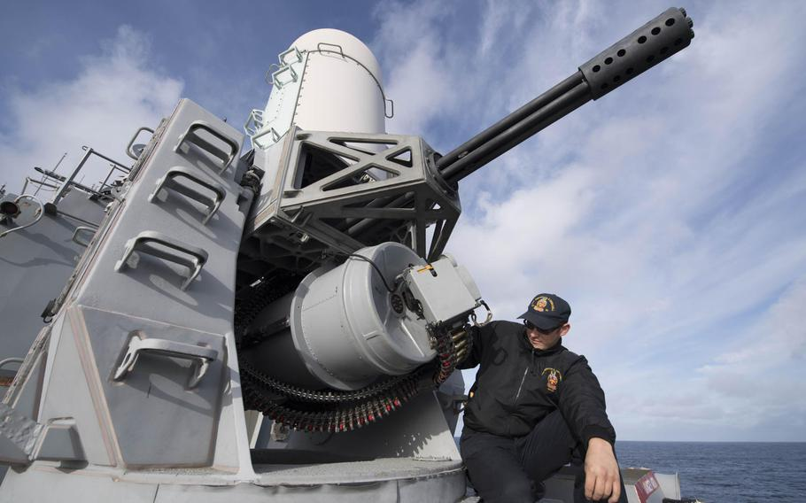 Fire Controlman 2nd Class Steven Tarver loads the Phalanx close-in weapons system aboard the Arleigh Burke-class guided-missile destroyer USS Winston S. Churchill during exercise Formidable Shield 2017 in the Atlantic Ocean, Sept. 25, 2017.