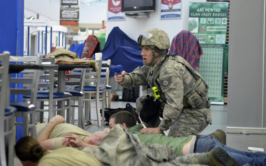 U.S. Air Force Tech. Sgt. Aaron Howard, 100th Security Forces Squadron, secures the area while searching and questioning simulated casualties during an active-shooter exercise at RAF Mildenhall, England, Wednesday, Oct. 18, 2017.