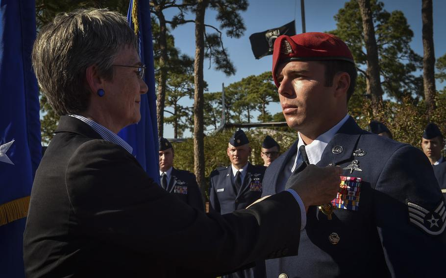 Secretary of the Air Force, Heather Wilson, pins the Air Force Cross on Staff Sgt. Richard Hunter, a Special Tactics Airman with the 23rd Special Tactics Squadron, during a combined medal ceremony at Hurlburt Field, Fla., Tuesday, Oct. 17, 2017.
