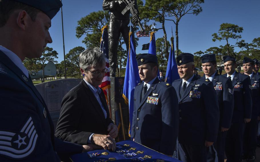 The Secretary of the Air Force, Heather Wilson, presents five members of Spooky 43, an AC-130U Spooky Gunship aircrew assigned to the 4th Special Operations Squadron, Distinguished Flying Crosses at Hurlburt Field, Fla., Tuesday, Oct. 17, 2017.