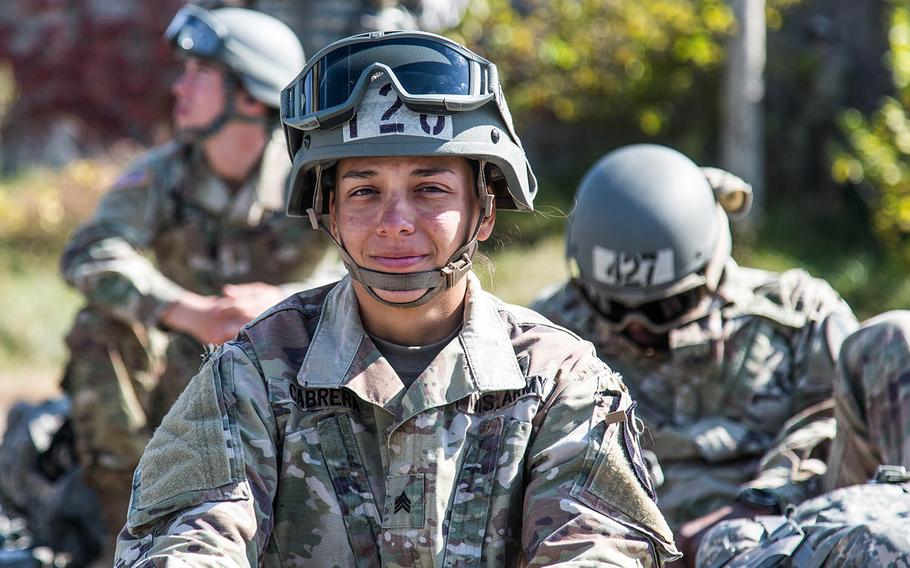 An air-assault student takes a breather after rappelling out of a helicopter at Camp Mobile, South Korea, Thursday, Oct. 19, 2017.