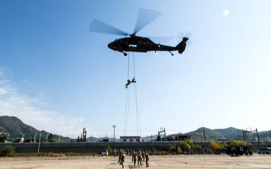 Two students rappel out of a helicopter at Camp Mobile, South Korea, Thursday, Oct. 19, 2017.