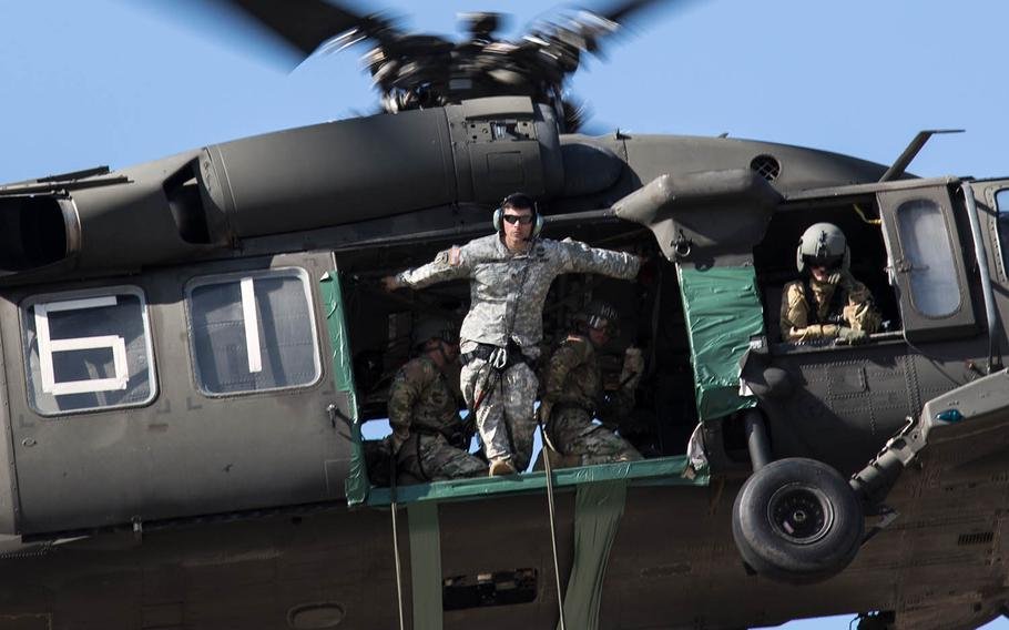 An air-assault instructor inspects a landing zone for his students at Camp Mobile, South Korea, Thursday, Oct. 19, 2017.