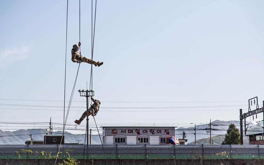 A pair of air-assault students rappel safely to the ground at Camp Mobile, South Korea, Thursday, Oct. 19, 2017.