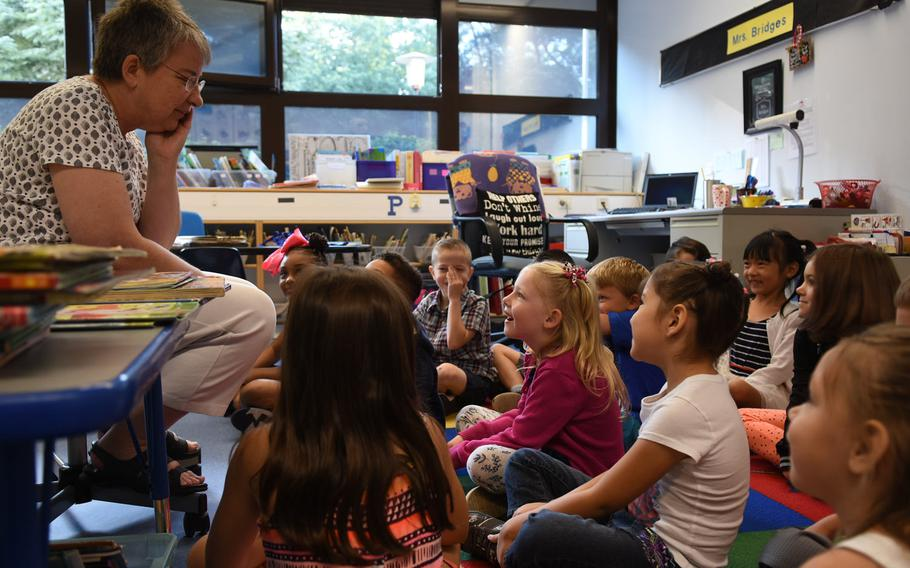 With her first-graders gathered around on the first day of school on Monday, Aug. 28, 2017, Ramstein Elementary School teacher Janet Bridges tries to remember names of all of her students.