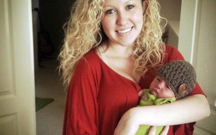 Katie Whiddon poses with her son, Camden, when he was a newborn.