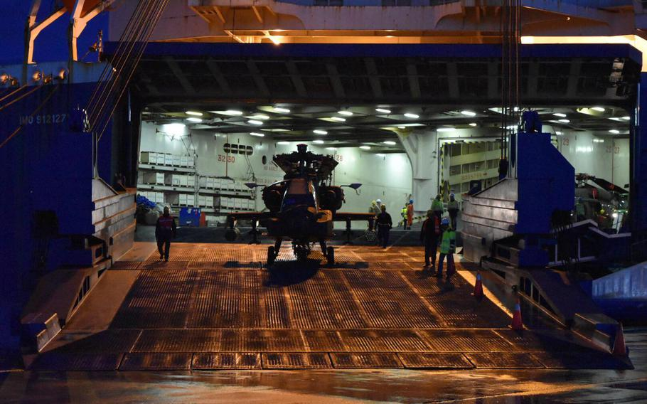 A U.S. Army 1st Air Cavalry Brigade AH-64 Apache helicopter is offloaded in Zeebrugge, Belgium, on Friday, Oct. 20, 2017.