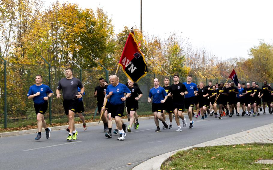 """Soldiers with Task Force Falcon, 10th Combat Aviation Brigade, run as part of the brigade's """"world run"""" event in Illesheim, Germany, on Friday, Oct. 20, 2017. Brigade soldiers ran simultaneously in 14 locations spanning the United States, Europe, the Middle East and South Korea."""