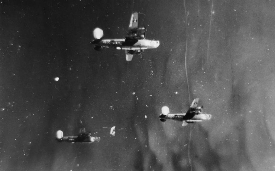 Three B-24 Liberators from the 844th Bomb Squadron, 489th Bomb Group fly in formation: Ford's Folly, top; Plucky Lady, right; and Bomber's Moon, left. Bomber's Moon crashed near Edenkoben, Germany with the loss of seven lives during a raid on Oct. 19, 1944. The bomber Pregnant Peggy got caught up in the prop wash of another aircraft, lost control and knocked off the Bomber's Moon tail section. On Oct. 19, 2017, family members of the Pregnant Peggy crew came to the crash site to dedicate a memorial to the lost men of both crews.