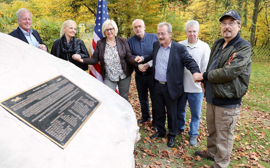 From left: Tom Burton; Mary Burton; Edenkoben Vice Mayor Angelika Fesenmeyer; Uwe Benkel, leader of Searching for the Missing; Edenkoben Mayor Olaf Gouase; John Torok; and Dennis Lithander come together Oct. 19, 2017, for the unveiling of a memorial for 14 servicemembers who died Oct. 19, 1944, during a B-24 bombing raid in Germany.