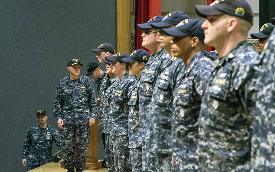 Seventh Fleet Commander Vice Adm. Phil Sawyer awards the Navy and Marine Corps Commendation Medal to 36 crew members of the USS Fitzgerald, Friday, Oct. 20, 2017.