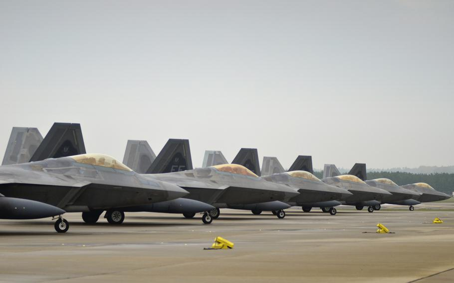U.S. Air Force F-22 Raptors of the 1st Fighter Wing before take-off at RAF Lakenheath, England, Thursday, October 19, 2017. The stealth fighter jets arrived earlier this month for training missions in the European theater as part of the European Deterrence Initiative