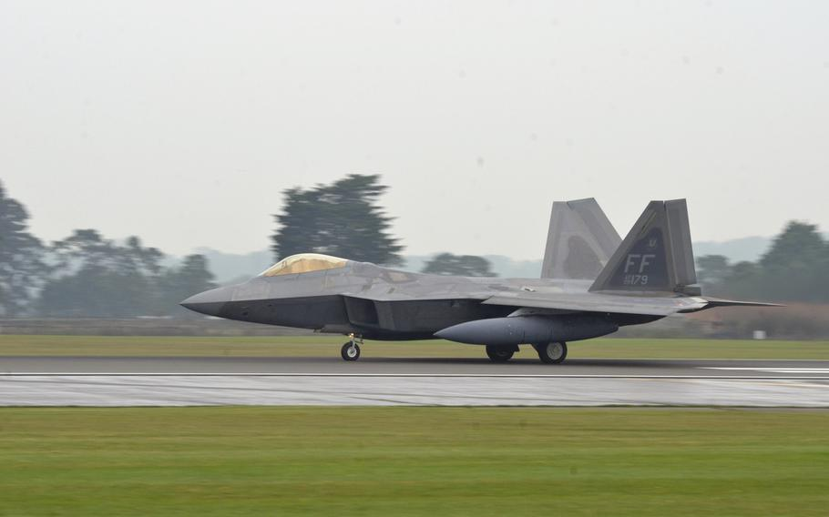 A U.S. Air Force F-22 Raptor of the 1st Fighter Wing takes off from at RAF Lakenheath, England, Thursday, October 19, 2017. Six of the stealth fighter jets arrived earlier this month for training missions in the European theater.