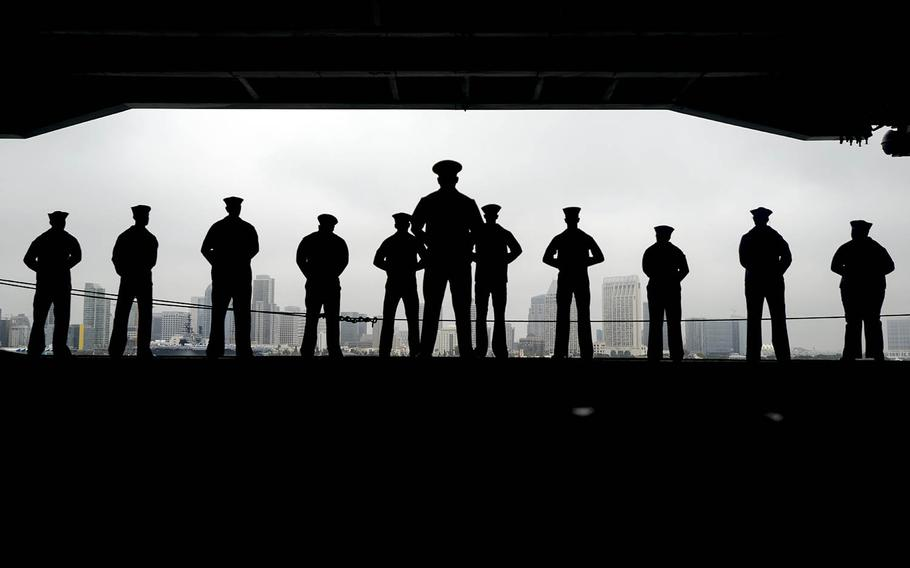 Sailors man the rails aboard the aircraft carrier USS Nimitz in San Diego, June 5, 2017.