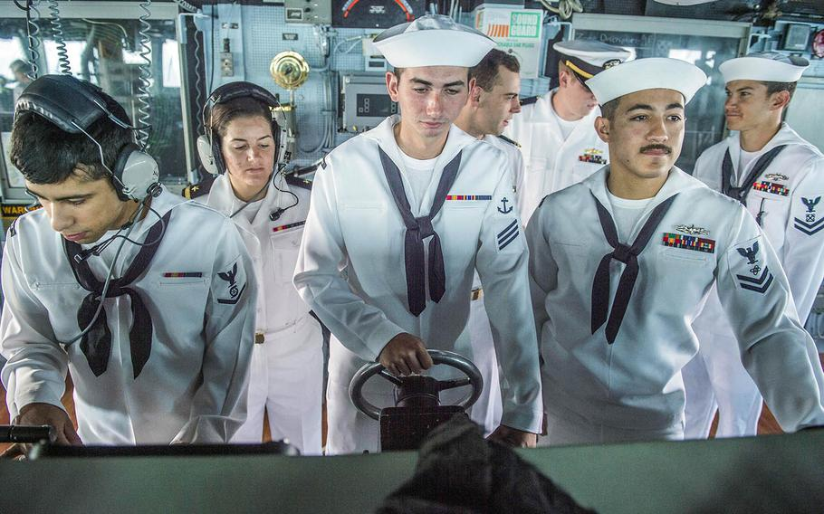 Sailors stand watch on the bridge of the guided-missile destroyer USS Fitzgerald as the ship arrives in Busan, South Korea, in 2015.