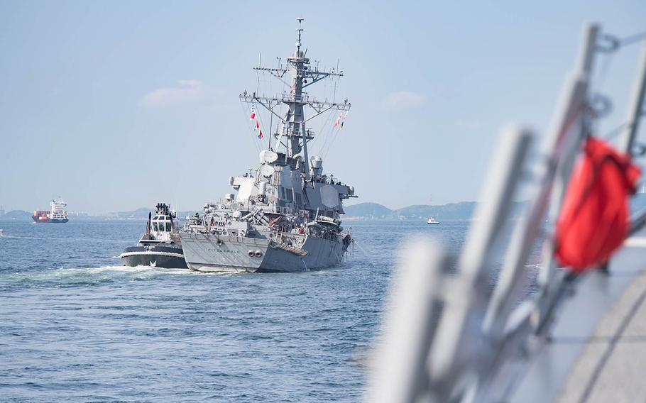 The guided-missile destroyer USS Fitzgerald returns to Yokosuka Naval Base after a collision with a merchant vessel off Japan.